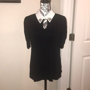 Black blouse by the brand LeRouge